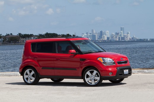 Stock Photo: 4093-17170 Front 3/4 static view of a 2010 red Kia Soul at the beach