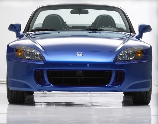 Stock Photo: 4093-17523 Nose view of a blue 2006 Honda S2000 photographed in the studio with a white background.