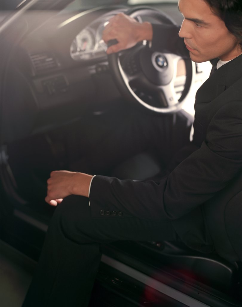 BMW M3 2002 guy inside dressed nice business suit : Stock Photo