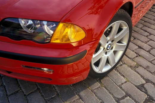 detail BMW 3 Series 1998 red nose headlight wheel turn signal fender 1990s street : Stock Photo
