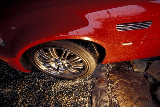 detail BMW M3 M Series 2001 red fender wheel tire vent stone street : Stock Photo