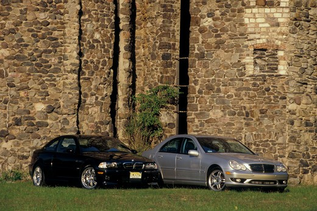 Stock Photo: 4093-18032 2004 Mercedes Benz C 240 BMW M3 wall stone