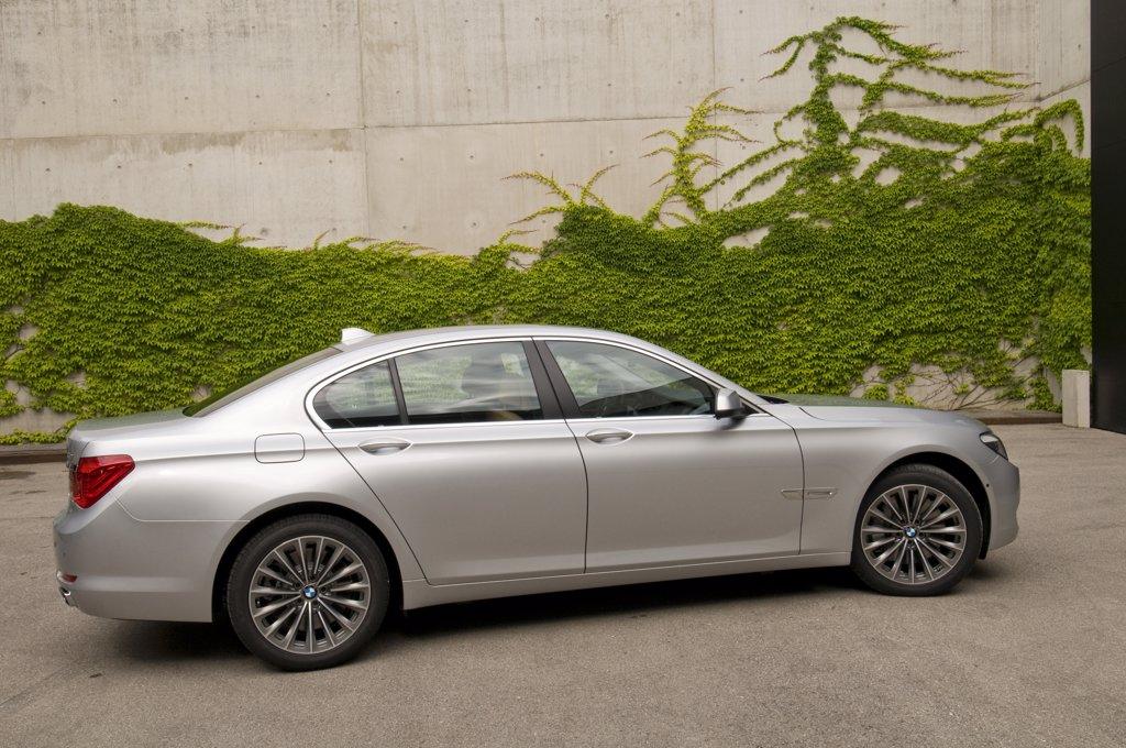 2009 BMW 750iL 7-Series The BMW 7 Series is a line of full-size luxury vehicles produced by the German automaker BMW. It replaced the New Six models. It is BMW's flagship car and is only available as a sedan. There have been five generations of the 7 Series : Stock Photo