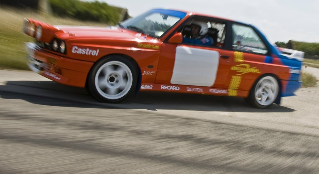 Stock Photo: 4093-18993 1987 BMW E30 / M3 Rally Car driving fast down an empty road