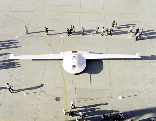 The Lockheed Martin/Boeing Tier III- (minus) unpiloted aerial vehicle is inspected by NASA personnel September 14  1995  following its arrival at the Dryden Flight Research Center  Edwards  California. : Stock Photo