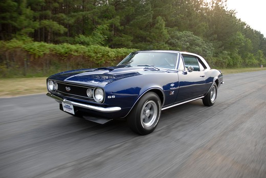 1969 Camaro SS, Super Sport Camaro, 1st-gen SS Camaro, Camaro SS The first-generation Camaro would last until the 1969 model year and would eventually inspire the design of the new retro fifth-generation Camaro. going fast speeding down the street : Stock Photo