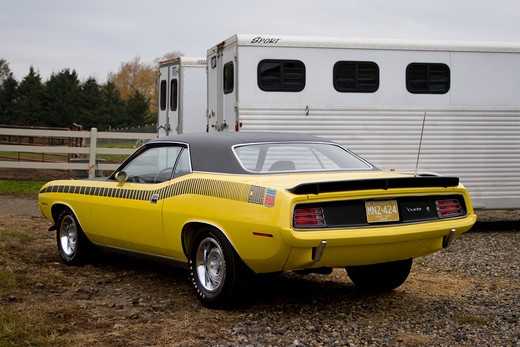 Stock Photo: 4093-20866 1970 plymouth AAR barracuda in the country next to a horse trailer