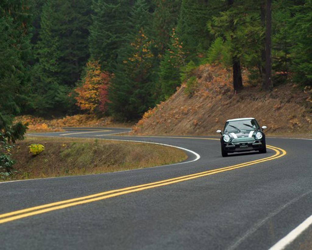 Stock Photo: 4093-21183 MINI Cooper 2002 green curve winding windshield wipers head on street