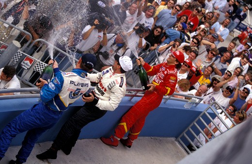 Stock Photo: 4093-21476 Greg Moore Michael Andretti Alex Zanardi driver CART Miami victory champagne race car