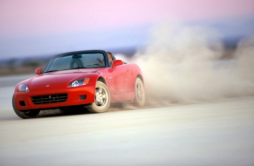 Stock Photo: 4093-21507 Honda S2000 2001 red slide cornering dust street