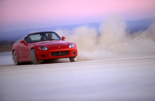 Honda S2000 2001 red slide cornering dust street : Stock Photo