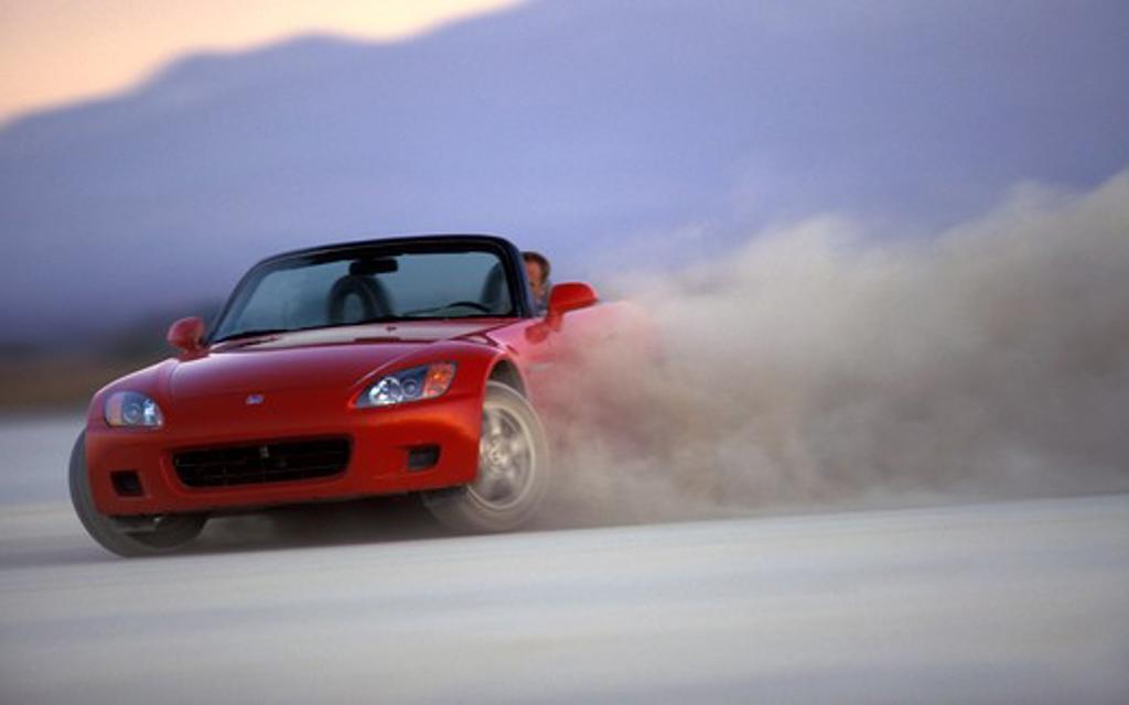 Stock Photo: 4093-21510 Honda S2000 2001 red slide cornering dust street