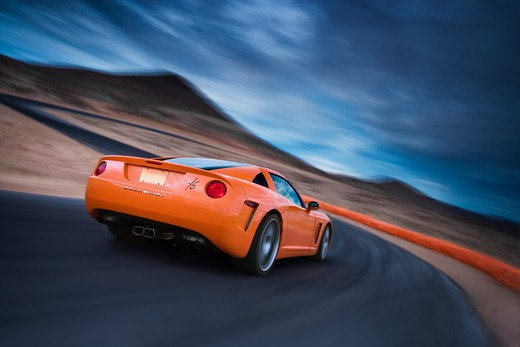 Stock Photo: 4093-22645 Rear 3/4 action view of a bright orange 2008 Callaway C16. Based on the C6 Chevrolet Corvette.