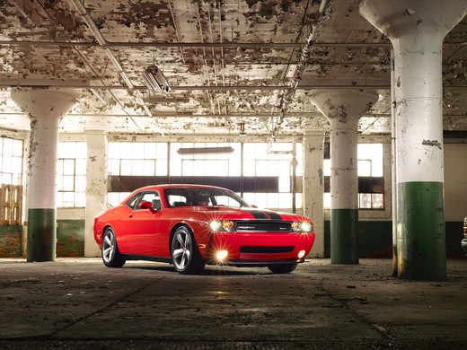 Stock Photo: 4093-22666 Front 3/4 static view of a 2009 Dodge Challenger in an abandoned warehouse, parking structure.