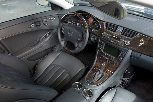 Stock Photo: 4093-23034 interior high angle Mercedes Benz CLS 500 2005 grey leather seats steering wheel wood trim dashboard