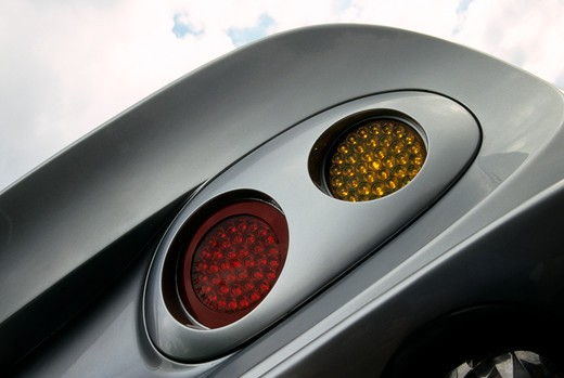 low angle detail Shelby Series One 002 silver tail light : Stock Photo