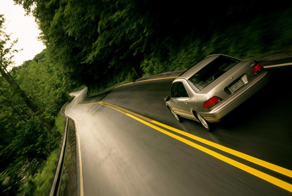 Lexus LS 430 2001 beige brake lights tail lights winding double yellow lines stripes : Stock Photo