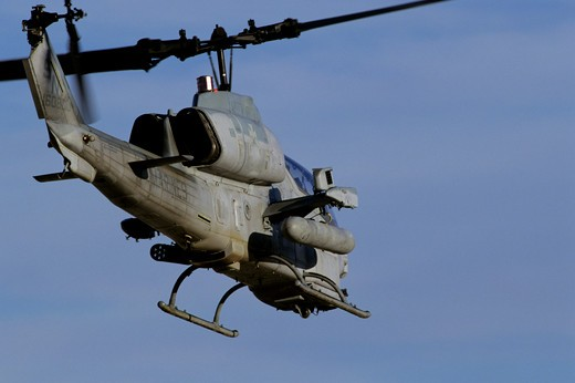 RVM000001	US Marine Corps Bell AH-1 Cobra equipped with rocket launchers departs Naval Air Field El Centro during day to day training operations. : Stock Photo