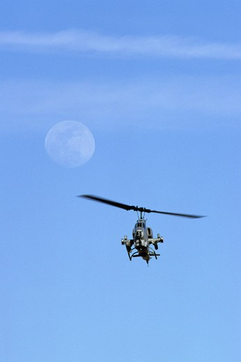 Stock Photo: 4093-24948 US Marine Corps AH-1 Cobra helicopter with full moon