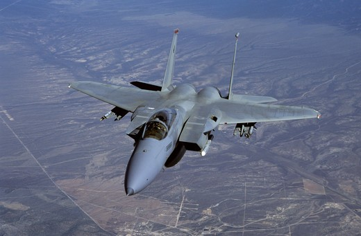 Stock Photo: 4093-24971 USAF F-15C Eagle from Langley AFB photographed from a USAF tanker above desert ground terrain