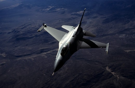 USAF Lockheed F-16C Fighting Falcon (Viper) over a mountain/desert background : Stock Photo