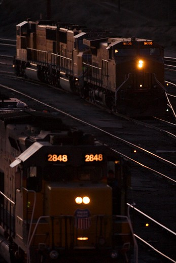 Diesel locomotives move through Union Pacific's West Colton freight yards in Colton California on their way to their next assignment. Train passing through in motion : Stock Photo