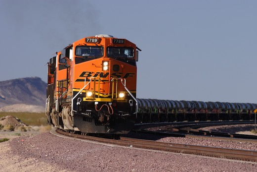 Stock Photo: 4093-25307 BNSF diesel electric locomotive # 7789 manufactured by General Electric model ES44DC at Goffs California with a coil steel train in tow. Diesel locomotives move through Union Pacific's West Colton freight yards Train passing through in motion