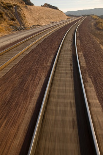 Point of view action of blurred railroad tracks : Stock Photo