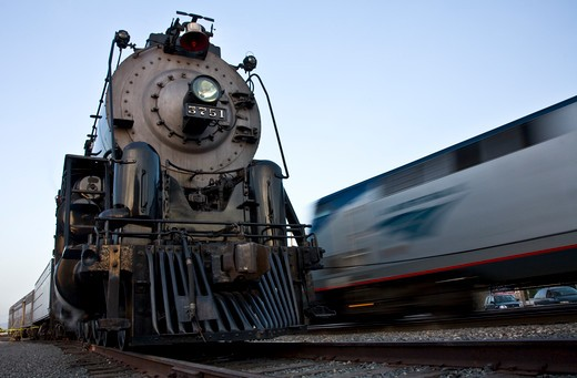 Stock Photo: 4093-25525 Stationary 1927 Santa Fe 3751 restored 4-8-4 steam locomotive next to passing freight train