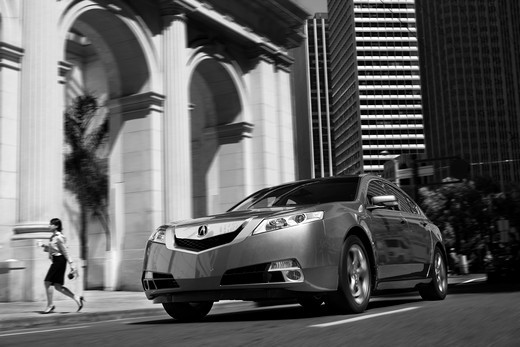 2009 Acura TL driving through city streets, front 3/4 : Stock Photo