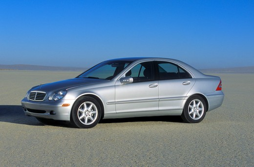 2003 Mercedes Benz C 240 in the desert salt flats dry lake bed : Stock Photo
