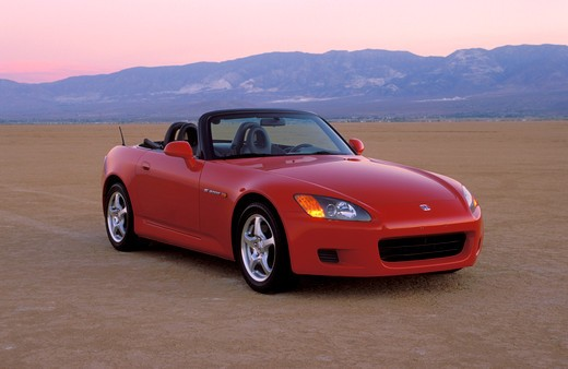 Honda 2000 S2000 red front 3/4 beauty dry lake bed sand street : Stock Photo