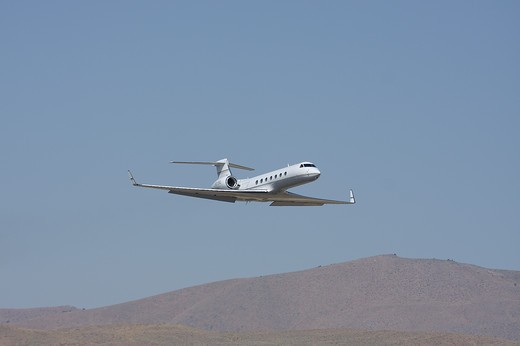 Gulfstream G550 G V SP flyby G flyby at the Reno Stead airport during the Reno Air Races. : Stock Photo