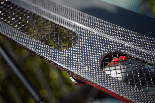 A close up detail shot of a 2006 Ferrari 430 Scuderia carbon fiber : Stock Photo