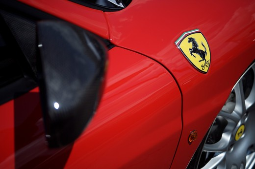 Stock Photo: 4093-28023 A close up detail shot of a 2006 Ferrari 430 Scuderia rearview mirror and logo