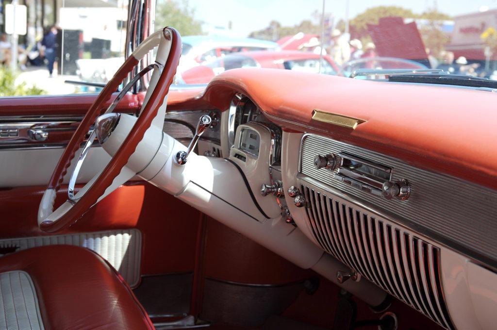 A close up detail shot of a chrome emblem on a 1957 Chevrolet Bel Air interior : Stock Photo