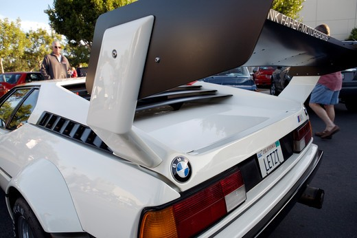 A close up detail shot of a BMW 1971 M1 rear tail and spoiler or wing : Stock Photo