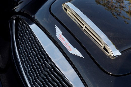 A close up detail shot of a 1959 Austin Healey 3000 hood and grill : Stock Photo