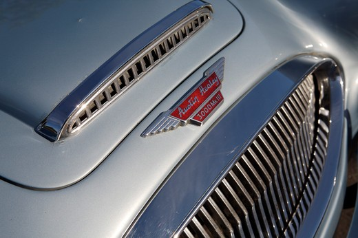 A close up detail shot of a 1967 Austin Healey 3000 hood and grill : Stock Photo