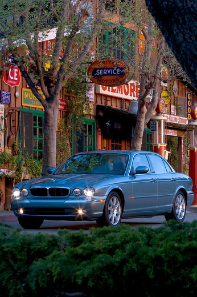Jaguar XJ8 2005 blue headlights : Stock Photo