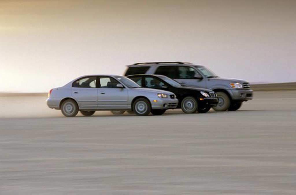 Stock Photo: 4093-3300 Toyota Mercedes Benz Hyundai Elantra C230 Land Cruiser silver black dusty