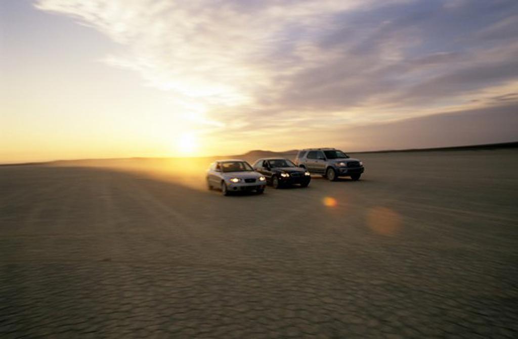 Toyota Mercedes Benz Hyundai Elantra C230 Land Cruiser silver black dusty lens flare : Stock Photo