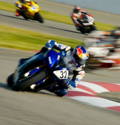 Stock Photo: 4093-3405 AMA motorcycle sports racing bike during a race.  a Yamaha leans into the turn with riders behind him