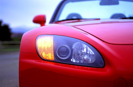 detail Honda S2000 2001 red headlight nose head on street : Stock Photo