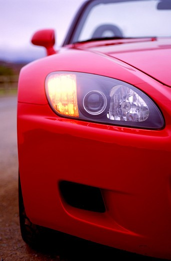 detail Honda S2000 2001 red nose headlight head on street : Stock Photo