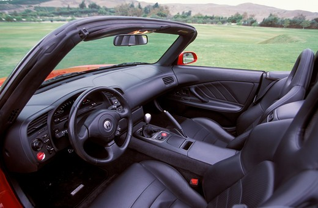 Stock Photo: 4093-4061 interior detail Honda S2000 2001 black leather seats steering wheel street