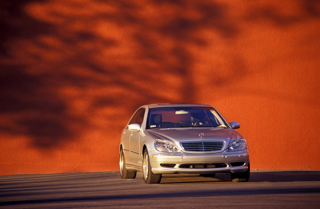 Mercedes-Benz 2003 C-Class parked next to wall : Stock Photo