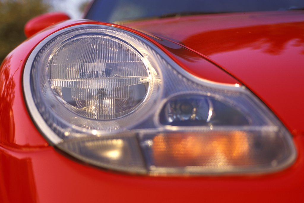 detail Porsche 911 Carrera 4 2001 red headlight head on : Stock Photo
