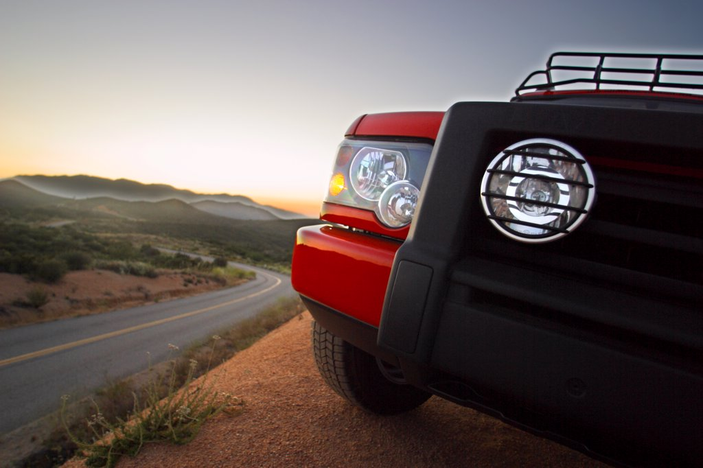 detail Land Rover G4 Discovery 2004 orange headlights : Stock Photo