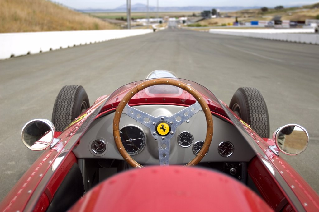 interior detail Ferrari 246 Dino red Formula One steering wheel wood gauges : Stock Photo
